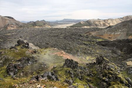 Iceland. Beautiful mountains and huge lava field. Famous volcanic area with rhyolite rocks - Landmannalaugar. photo