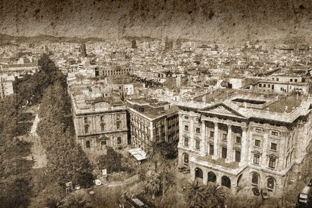 the ramblas: Barcelona cityscape. Aerial view seen from the Columbus Column. Famous Ramblas on the left, Gobierno Militar building on the right. Stock Photo