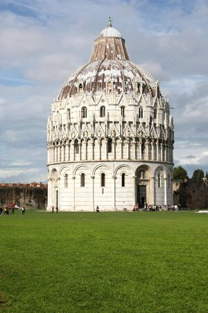 Pisa, Tuscany, Italy. Famous baptistery at Piazza Del Duomo. UNESCO World Heritage List landmark. photo