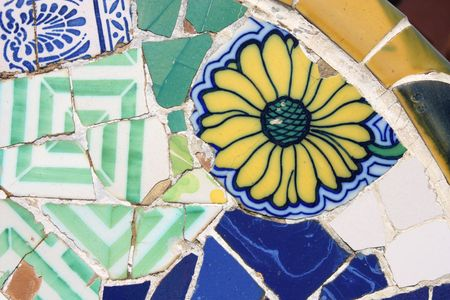 trencadi: Floral mosaic in Antoni Gaudis Park Guell - Barcelona detail. Artistic background texture of trencadis.
