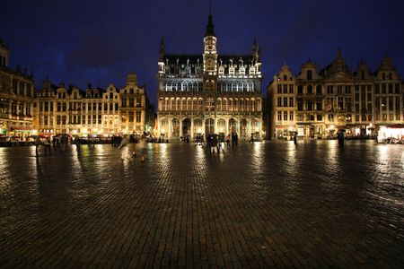 cobbled: Famous building: Maison du Roi (The Kings House or Het Broodhuis) in Brussels, Belgium. Located on Grote Markt (Main Square). Rainy evening, wet cobble stones.