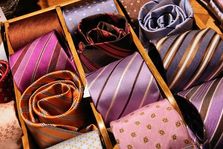 Shopping for elegant dressing accessories. Colorful ties at a shop in Italy. Formal wear selection in a store.