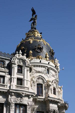 Madrid, Spain. Metropolis Building - vintage office architecture in Romanesque Revival style. photo
