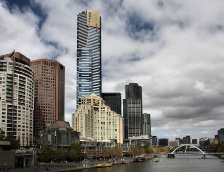 Skyline of Melbourne and Yarra River. The prominent building is Eureka Tower, which is the worlds tallest residential tower when measured to its highest floor.