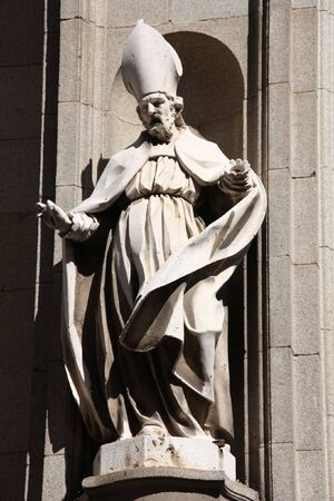 Bishop statue in the facade of Toledo Cathedral, Spain photo