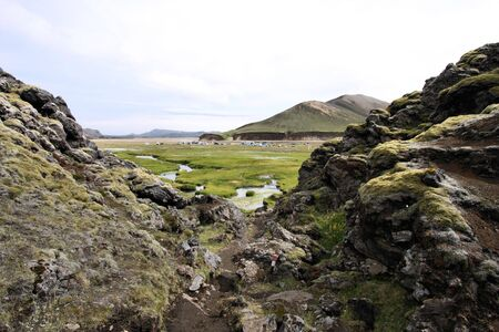 Iceland. Beautiful mountains, green valley and lava rocks. Famous volcanic area with rhyolite rocks - Landmannalaugar. photo