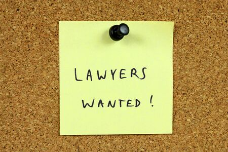 Yellow sticky note pinned to an office notice board. Lawyers wanted - legal career recruitment message. Stock Photo - 6809030