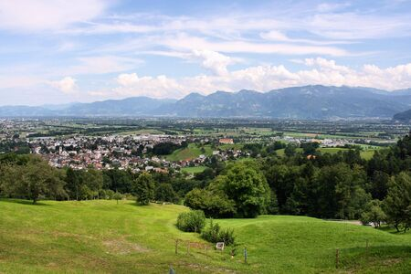 gall: Landscape of Switzerland - green meadows and the Alps. Altstatten town in the canton of St. Gall.