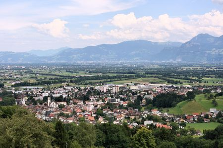 gall: Landscape of Switzerland - green valley and the Alps. Altstatten town in the canton of St. Gall.