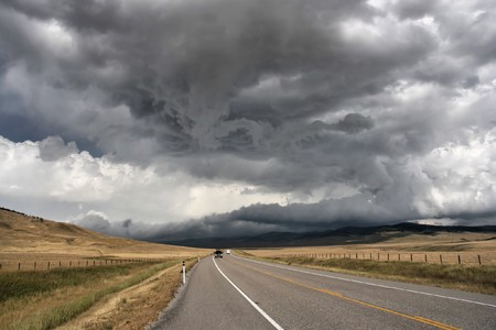 storm clouds: Prairie road in Alberta, Canada. Imminent storm.