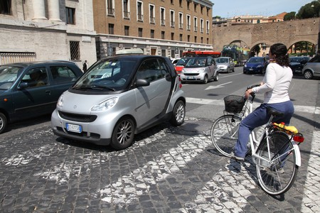 ROME - MAY 9: Ever congested streets on May 9, 2010 in Rome, Italy. Traffic jam and alternative - bicycle.