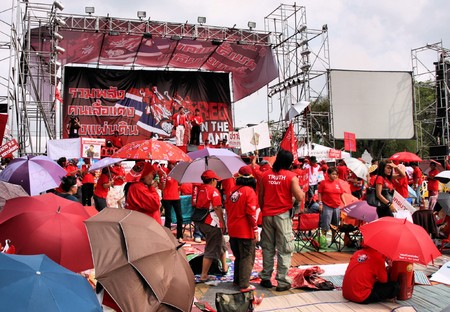 resulted: BANGKOK - APRIL 2, 2009: Red Shirt protesters on Bangkok streets on April 2, 2009. Anti government protests in Thailand intensified in mid-April, which resulted in state of emergency declared in Bangkok.