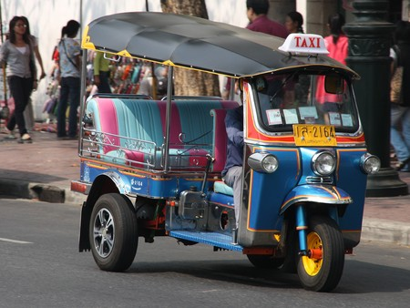 resulted: BANGKOK - JANUARY 23, 2009: Famous three wheeled taxi in Thailand - tuk tuk motorcycle on January 23, 2009. Use of CNG gas power in tuktuks resulted in the improvement of air quality, however the pollution levels are still too high.