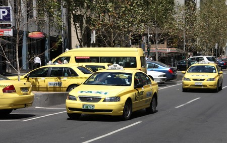 valued: MELBOURNE - FEBRUARY 9, 2009: Yellow cabs in Melbourne on February 9, 2009. Taxi licence in Melbourne is one of the most expensive in the world, valued at around $464,000. Editorial