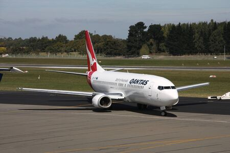 15 18: CHRISTCHURCH, NZ - MARCH 18: Qantas Jetconnect aircraft after pushback at Christchurch International Airport on March 18, 2009. On April 15 Qantas announced the deferment of new aircraft delivery due to the financial crisis.