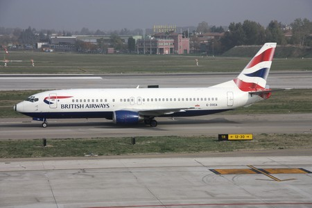BOLOGNA - OCTOBER 29: Boeing 737 of British Airways taxiing on October 29, 2009 at Bologna International Airport. On November 12, 2009, British Airways confirmed that it is going to merge with Iberia Airlines. The new airline will become the world's third Stock Photo - 7137746