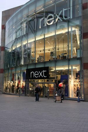 retailer: BIRMINGHAM - MARCH 9: Next store on March 9, 2010 in Birmingham, UK. According to Daily Express, Next is the third largest British retailer and sixth most important British brand.