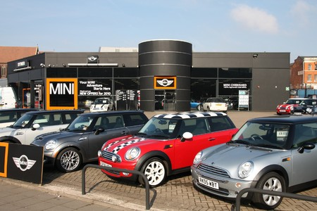 lot: BIRMINGHAM - MARCH 11: Mini cars dealer on March 11, 2010 in Birmingham, UK. According to Car Dealer Magazine, Mini was the 7th best selling car in the UK in 2009.