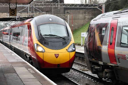 power operated: COVENTRY - MARCH 12: Pendolino train operated by Virgin Trains on March 12, 2010 in Coventry, UK. Virgin Trains Pendolinos are notable for returning 17% of the power the use to the power grid (enough for 15,000 homes for year).