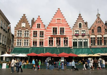 BRUGES - AUGUST 23: Town square (Markt) on August 23, 2008 in Bruges, Belgium. According to Lonely Planet, Bruges is one of Western Europes most-visited medieval cities.