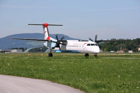 bombardier: SALZBURG - AUGUST 6: Bombardier Dash 8 aircraft operated by Austrian Arrows on August 6, 2008 at Salzburg International Airport. Dash 8 is the most produced turboprop aircraft currently in operation.