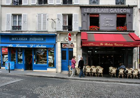 cobbled: PARIS - AUGUST 19, 2008: People strolling in Paris on August 19, 2008. Small cafes and shops in famous Montmartre district are one of the reasons Paris was the worlds most visited cities in 2008. Editorial