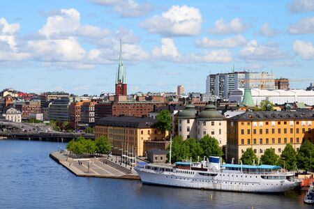Stockholm, Sweden. View of famous Gamla Stan (the Old Town), Riddarholmen island. Restaurant and hotel ship. photo