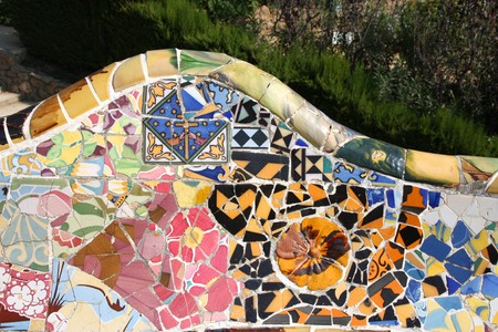 modernisme: Artistic mosaic in Antoni Gaudis Park Guell - Barcelona detail. Stock Photo