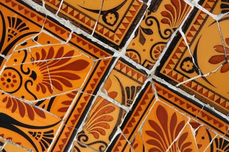 trencadi: Artistic mosaic in Antoni Gaudis Park Guell - Barcelona detail. Background texture of trencadis.
