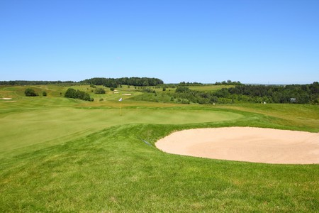 Golf course in Poland, Malopolska region. Green golf fields with sand trap. photo