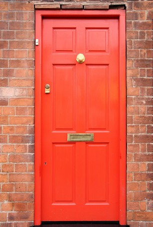 Birmingham. Old brick building and red door. West Midlands, England. photo