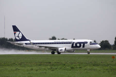 chopin: WARSAW - AUGUST 31: Embraer 175 of LOT Polish Airlines taking off on August 31, 2010 from Warsaw Chopin airport in Poland. As of 2010, Embraer 175 has a flawless safety record. Editorial