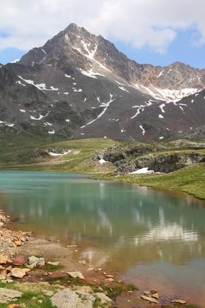 gavia: Italy. Lake at Gavia Pass in Stelvio National Park. Ortler Alps. In background: Corno dei Tre Signori peak, 3360m high.