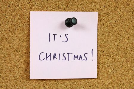 Pink sticky note pinned to an office notice board. Christmas coming. Stock Photo - 7852920