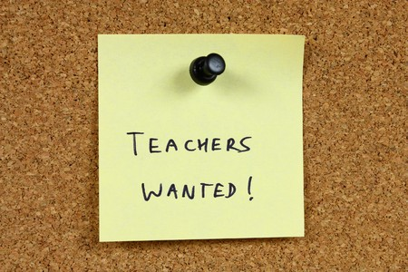 Teachers wanted - education career opportunity. Job recruitment. Yellow sticky note pinned to an office notice board. Stock Photo - 7852916