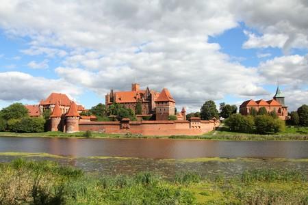 teutonic: Malbork castle in Pomerania region of Poland. UNESCO World Heritage Site. Teutonic Knights fortress also known as Marienburg. Nogat river.