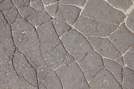 bad condition: Damaged road. Background abstract of asphalt surface in bad condition - cracked tarmac.