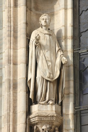 saint stephen cathedral: Saint Stephen, the martyr (or protomartyr - the first of martyrs). One of statues in the Cathedral of Milan (Italy). Stock Photo