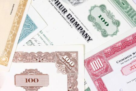 Stock exchange collectibles. Old stock share certificates from 1950s-1970s (United States). Vintage scripophily objects (obsolete). photo