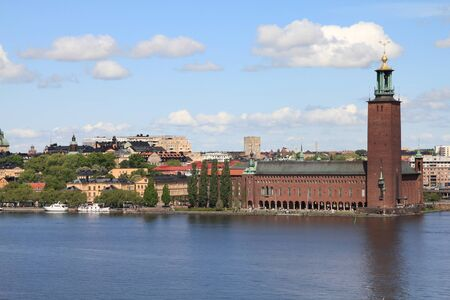 Stockholm, Sweden. Skyline of Kungsholmen island with famous City Hall (Stadshuset) seen from Sodermalm island, across Riddarfjarden channel. Stock Photo - 8080258