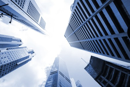 financial district: Skyscrapers in Singapore, Asia. City view with wide angle lens, looking straight up. Stock Photo