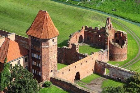 Malbork castle in Pomerania region of Poland. UNESCO World Heritage Site. Teutonic Knights fortress also known as Marienburg. photo