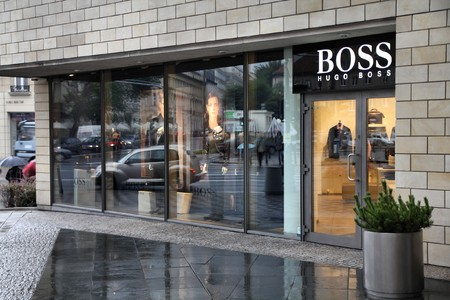 hugo: WARSAW - SEPTEMBER 7: Hugo Boss store on September 7, 2010 in Warsaw, Poland. Hugo Boss was boycotted by actor Danny Glover in March 2010, because of planned Ohio factory closure with production moving to Turkey and Bulgaria. Editorial