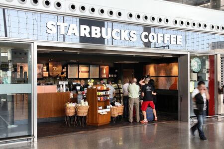 malaga: MALAGA - OCTOBER 14: Starbucks Coffee on October 14, 2010 at Malaga International Airport. With 17,800 stores it is largest coffeehouse company worldwide. Starbucks had USD 391 million net income in 2009.