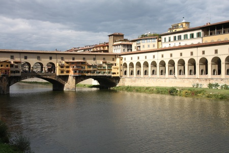 ponte: Cityscape of Florence, Italy with river Arno reflection. Uffizi Gallery and famous Ponte Vecchio bridge.