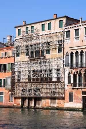 Venice, Italy. Safety scaffolding on old architecture, water canal and boats. Stock Photo - 8318391
