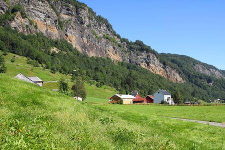 hardanger: Norway - beautiful village in Hardanger district. Green pastures.