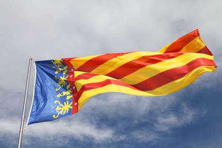 autonomic: Flag of Comunidad Valenciana, region in Spain. Moving in the wind.