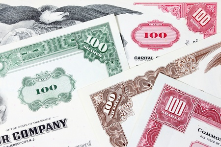 Stock market collectibles. Old stock share certificates from 1950s-1970s (United States). Vintage scripophily objects (obsolete). photo