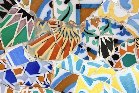 trencadi: Colorful mosaic in Antoni Gaudis Park Guell - Barcelona detail. Artistic background texture of trencadis. Stock Photo